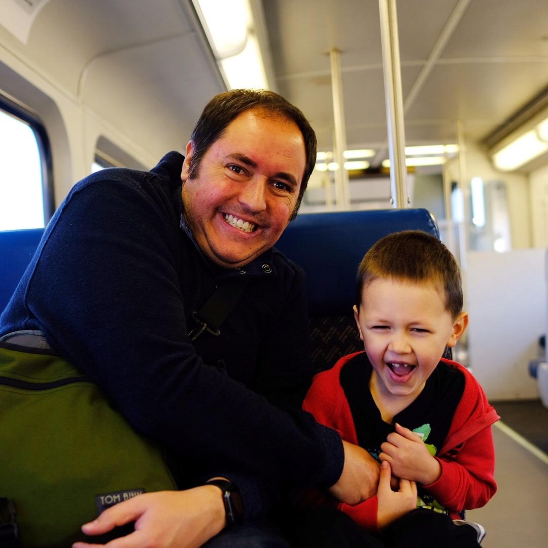 Joel tickles Emmett while riding on the FrontRunner train.